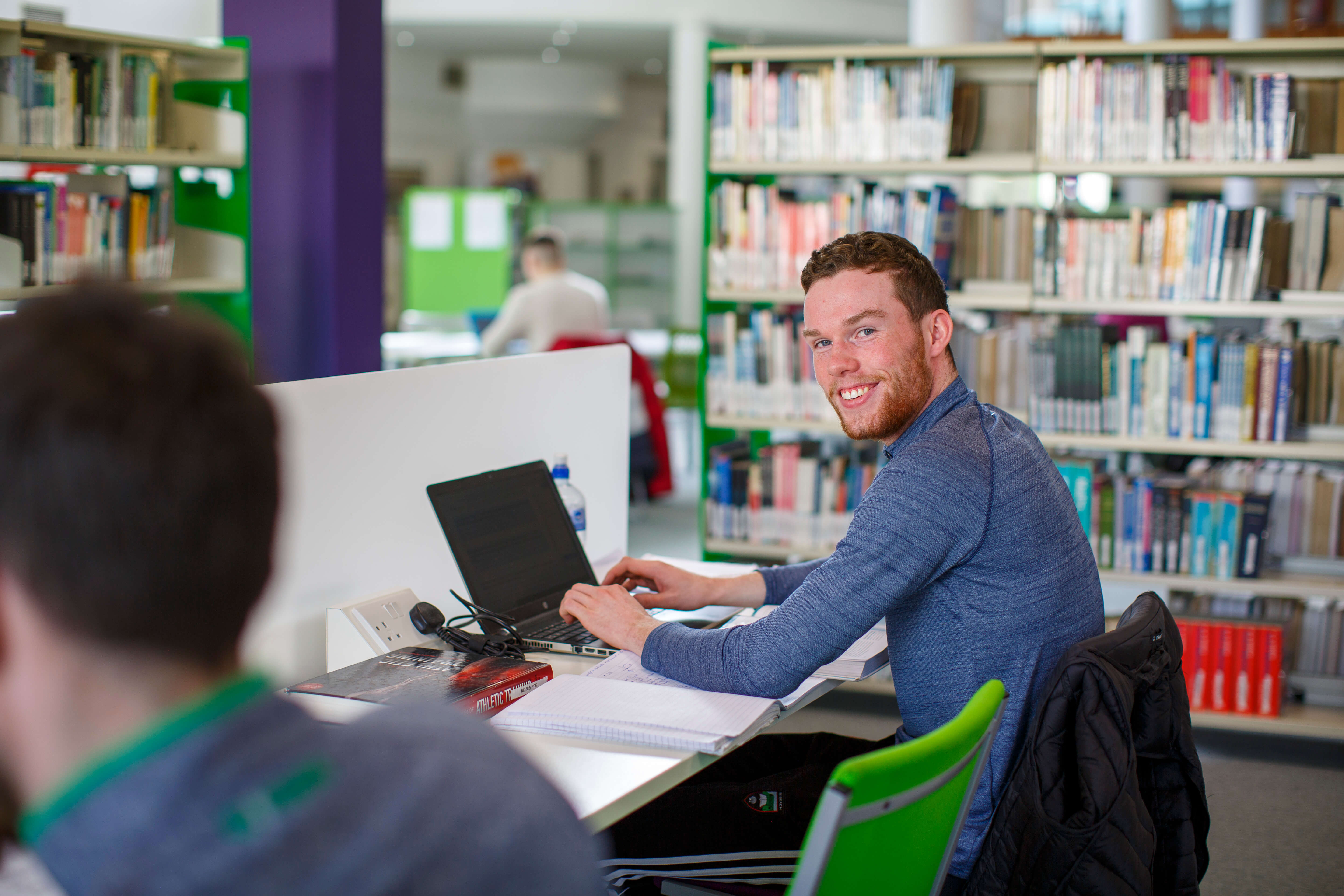 Students in the AIT Library Using Laptops