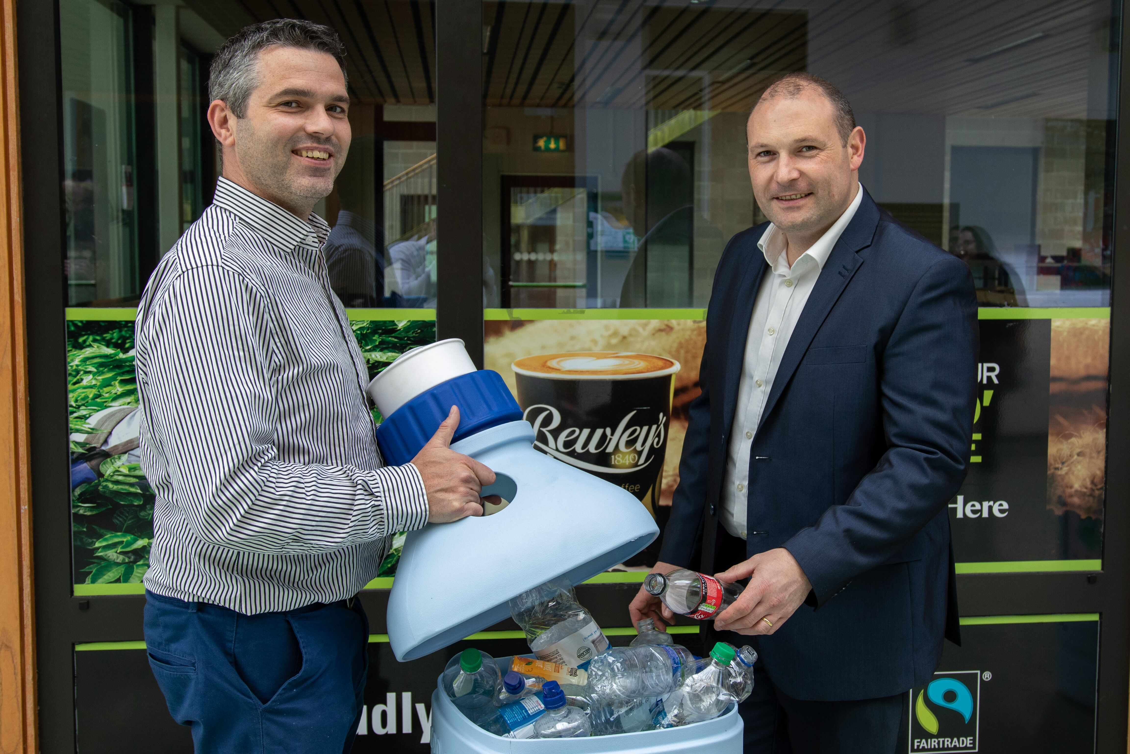 Dr Declan Devine, Director of the Materials Research Institute, with Dr Noel Gately, APT Centre Manager posing for the 'Banking on Bottles' initiative