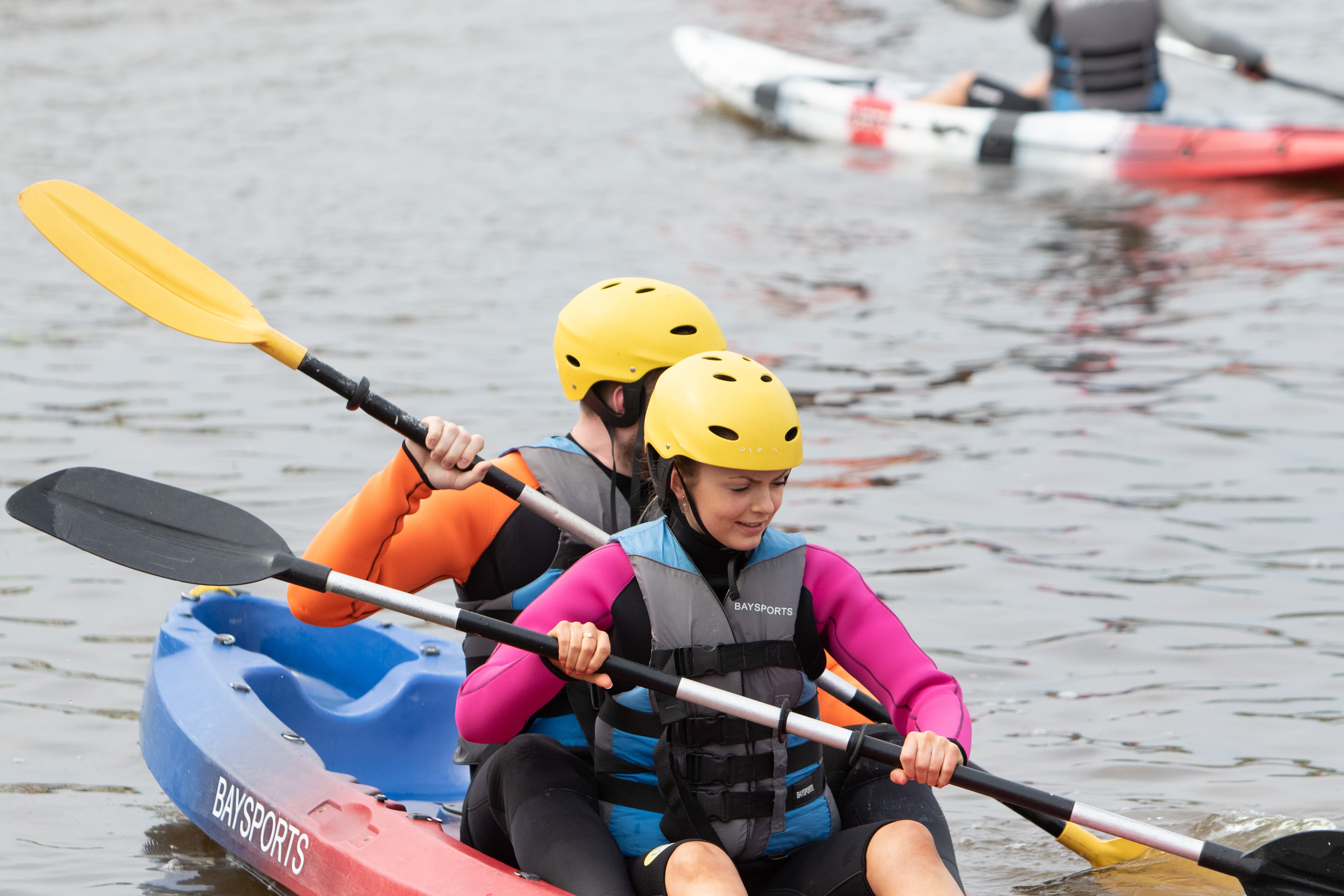 Delegates participating in water sports at Bay Sports